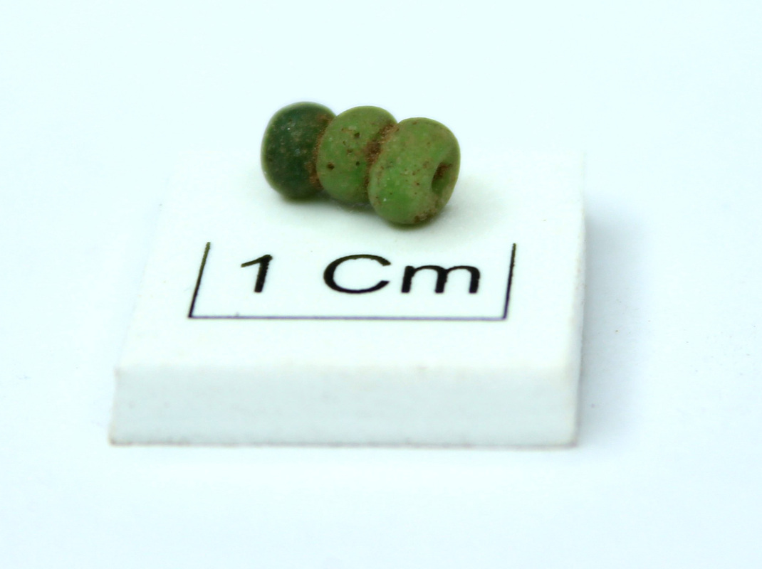 Image of segmented glass bead recovered from Glenshee, from http://www.glenshee-archaeology.co.uk/news/mystery-of-the-glass-bead-uncovered